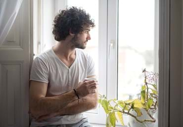 Man-looking-out-of-window-iStock-515963168_ContentFull.jpg