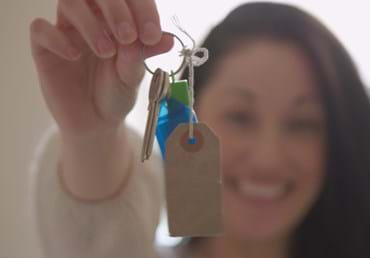 Shared Ownership customer Nina with keys to new home.jpg