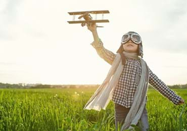 Child flying model plane - istockphoto.jpg