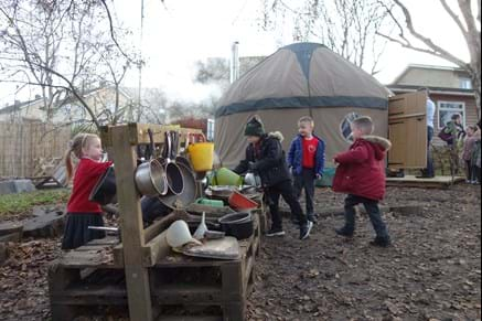 Twerton Infant School pupils in their forest school play area